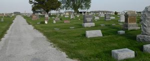The road leading into Rossville Cemetery with headstones to the right.