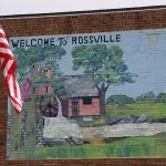 Welcome to Rossville mural on side of building next to American flag