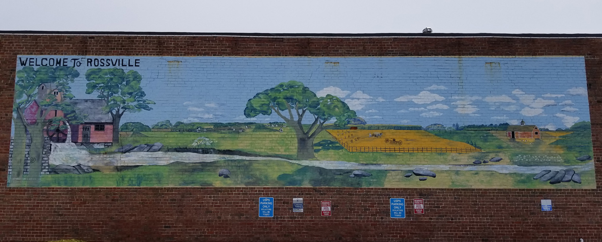 Welcome to Rossville Mural painted on the side of a brick building